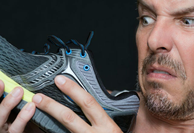 man-disgusted-by-shoes-smell-royalty-free-image-495114050-1550855138